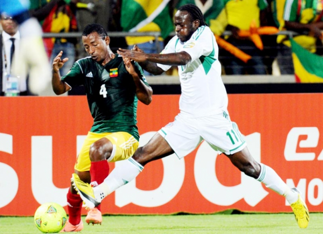Ethiopia-Nigeria - Abebaw Butako and Victor Moses (Photo: Alexander Joe / AFP)